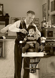 20 March 2016. New Orleans, Louisiana. <br /> New Orleans' bespoke gentlemen's barber  Aidan Gill gives Jac Mendoza a haircut.<br /> Photo; Charlie Varley/varleypix.com