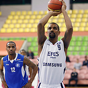 Efes Pilsen's Preston SHUMPERT (R) and Antalya BSB's Aaron JACKSON (L) during their Turkish Basketball league match Efes Pilsen between Antalya BSB at the Ayhan Sahenk Arena in Istanbul Turkey on Wednesday 21 April 2010. Photo by Aykut AKICI/TURKPIX