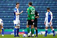 Blackburn Rovers midfielder Darragh Lenihan (26) and Birmingham City midfielder Gary Gardner (20) during the EFL Sky Bet Championship match between Blackburn Rovers and Birmingham City at Ewood Park, Blackburn, England on 8 May 2021.