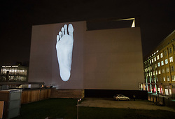 © Licensed to London News Pictures. 17/01/2018. London, UK. Photographs of the feet of the dancers from Rambert are projected onto the side of the world famous dance company's new building in a piece entitled 'Light On Their Feet' ?by artist David Wardd during the Lumiere London festival. Running from 18th-21st January 2018 more than 50 artworks are transforming the capital's streets, buildings and public spaces into an immersive nocturnal art exhibition of light and sound. Locations include King's Cross, Fitzrovia, Mayfair, West End, Trafalgar Square, Westminster, Victoria, South Bank and Waterloo. Photo credit: Peter Macdiarmid/LNP