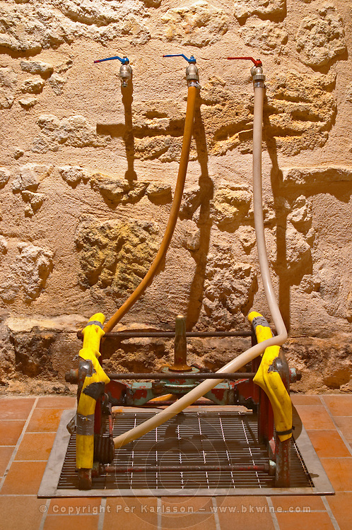 A device to clean the barriques. they are put upside down (bung hole facing down). The spigot in the middle sprays hot water on the inside to clean it - Chateau Grand Mayne, Saint Emilion, Bordeaux