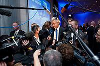 """02 OCT 2010, BERLIN/GERMANY:<br /> Geert Wilders (M), Vorsitzender Partij voor de Vrijheid Niederlande, im Gespraech mit Journalisten und umringt von Fotografen und Kameraleuten, nach der Rede von Wilders, Veranstaltung """"Islam und Integration"""", Hotel Berlin<br /> IMAGE: 20101002-01-074<br /> KEYWORDS: Mikrofon, microphone, Kamera, Camera"""