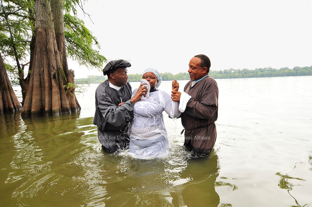 Description/Caption:<br /> A 100 yr. Tradition of rural African American Baptisms on Moon Lake, in the Mississippi Delta held once a year in the same spot on the lake. The First candidate for baptism is pictured in the water before he is Baptised. (photo © Suzi Altman)