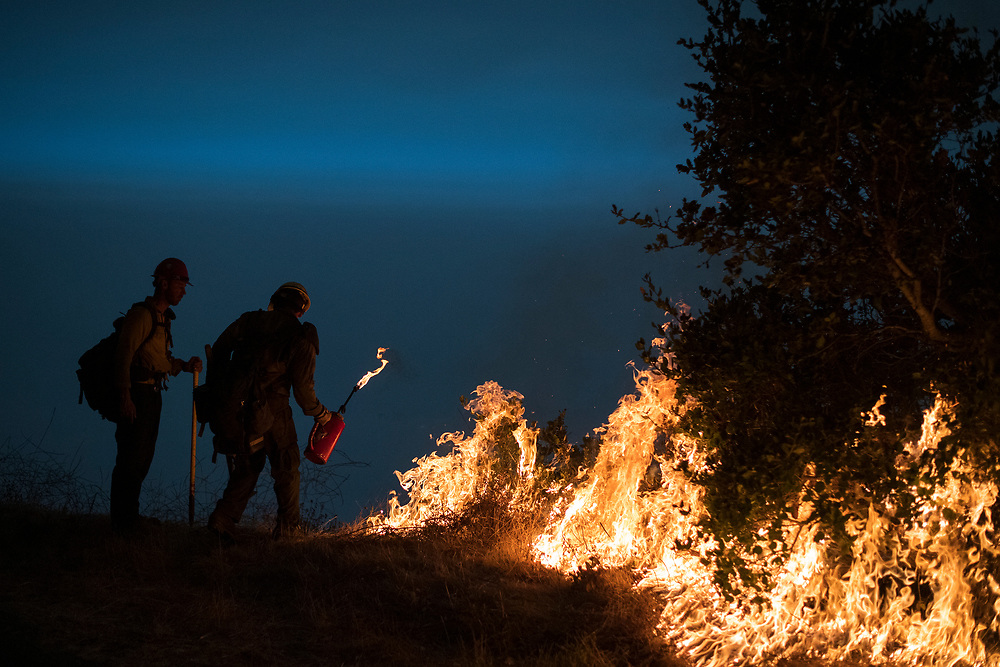 Firefighters light a controlled burn along Nacimiento-Fergusson Road to help fight the Dolan Fire near Big Sur, Calif. on Sept. 11, 2020.