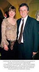 VISCOUNT & VISCOUNTESS ASTOR at a reception in London on 31st october 2002.PES 90