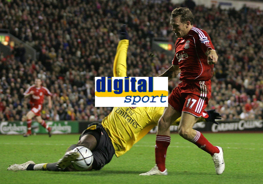 Photo: Paul Thomas.<br /> Liverpool v Arsenal. Carling Cup. 09/01/2007.<br /> <br /> Liverpool's Craig Bellamy has the ball tackled from him by Johan Djourou.