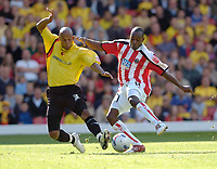 Photo: Leigh Quinnell.<br /> Watford v Sheffield United. Coca Cola Championship.<br /> 17/09/2005. Sheffield Uniteds Steven kabba and Watfords Jordan Stewart battle for the ball.
