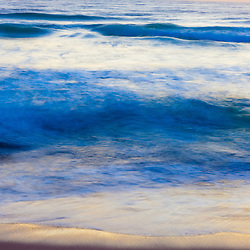 Early morning light reflects in the surf at Coast Guard Beach in the Cape Cod National Seashore in Eastham, Massachusetts.