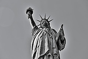 SHOT 3/9/15 12:40:20 PM - The Statue of Liberty is a colossal neoclassical sculpture on Liberty Island in New York Harbor in New York City, in the United States. The statue, designed by Frédéric Auguste Bartholdi, a French sculptor and dedicated on October 28, 1886, was a gift to the United States from the people of France. The statue is of a robed female figure representing Libertas, the Roman goddess, who bears a torch and a tabula ansata (a tablet evoking the law) upon which is inscribed the date of the American Declaration of Independence, July 4, 1776. A broken chain lies at her feet. The statue is an icon of freedom and of the United States: a welcoming signal to immigrants arriving from abroad. New York is the most populous city in the United States and the center of one of the most populous urban agglomerations in the world—the New York metropolitan area. The city is referred to as New York City or the City of New York to distinguish it from the State of New York, of which it is a part. A global power city, New York exerts a significant impact upon commerce, finance, media, art, fashion, research, technology, education, and entertainment. New York City has often been described as the cultural and financial capital of the world. (Photo by Marc Piscotty / © 2015)