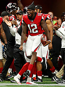 Mohamed Sanu celebrates during an NFL preseason football game between the Arizona Cardinals and the Atlanta Falcons, Friday, August 26, 2017 in Atlanta. (Photo by Mike Zarrilli/Panini)