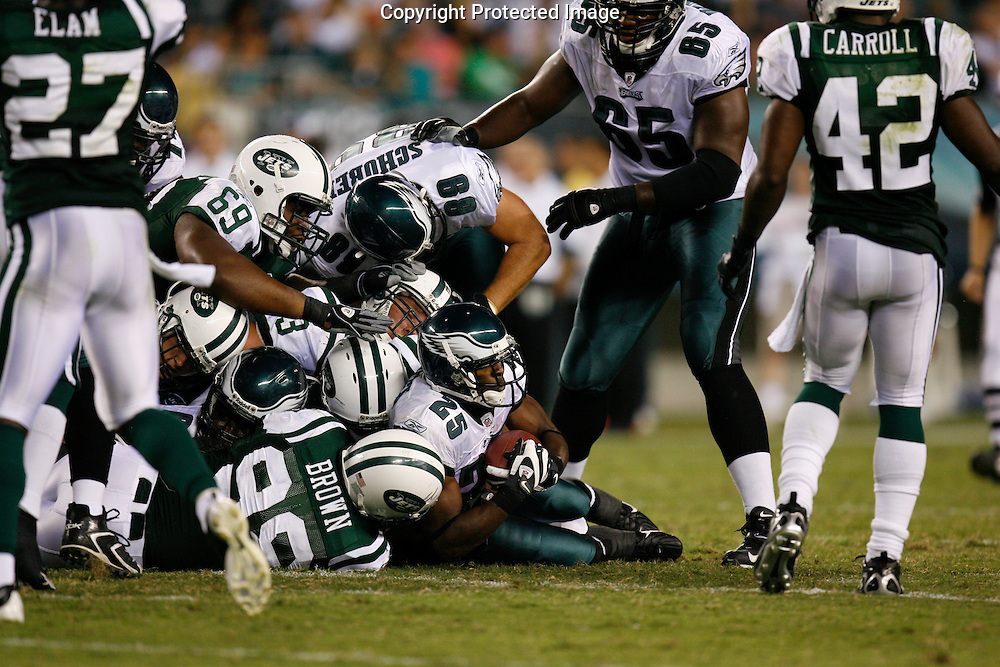 28 August 2008: Philadelphia Eagles running back Lorenzo Booker #25 is brought down by the Jets defense during the game against the New York Jets on August 28, 2008. The Jets beat the Eagles 27 to 20 at Lincoln Financial Field in Phialdelphia, Pennsylvania.