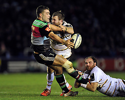 Nick Easter of Harlequins offloads the ball after being tackled - Photo mandatory by-line: Patrick Khachfe/JMP - Mobile: 07966 386802 17/01/2015 - SPORT - RUGBY UNION - London - The Twickenham Stoop - Harlequins v Wasps - European Rugby Champions Cup