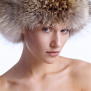 Close up of beautiful woman's face wearing a coyote fur hat
