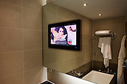 Late-night erotica on screen in luxury room at hotel chain Sofitel at Heathrow Airport's Terminal 5.