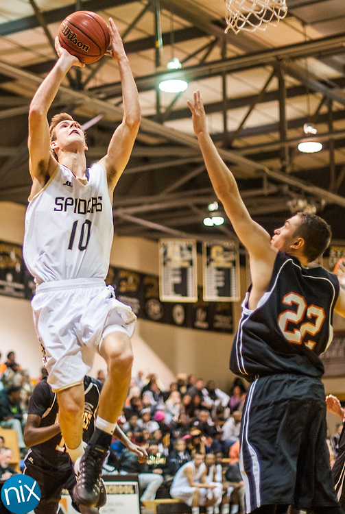 Concord's Connor Burchfield takes a shot against Northwest Cabarrus Tuesday night at Concord High School. Concord won the game 89-49.