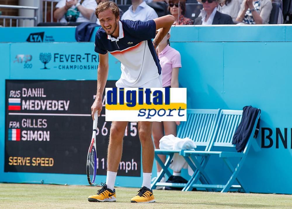 Tennis - 2019 Queen's Club Fever-Tree Championships - Day Six, Saturday<br /> <br /> Men's Singles, Semi Final: Daniil Medvedev (RUS) Vs. Gilles Simon (FRA) <br /> <br /> Daniil Medvedev (RUS) grimaces in pain after pulling his back on Centre Court.<br />  <br /> COLORSPORT/DANIEL BEARHAM