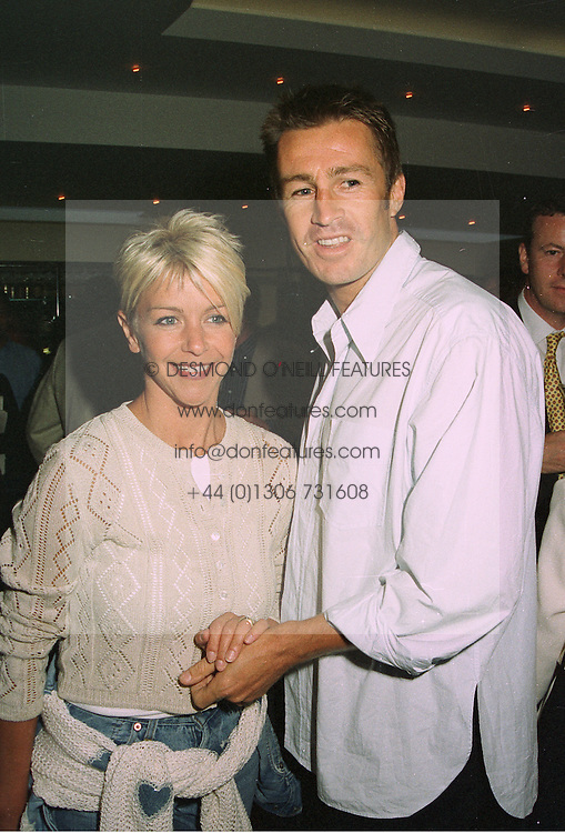 Actress LESLEY ASH and her husband LEE CHAPMAN  at a party in London on 27th August 1997.MAU 32