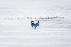 """THEMENBILD - zur Beschleunigung der Schneeschmelze bringt ein Traktor Dünger entlang der Schlepplift-Trasse aus aus. Sturmtief """"Ulla"""" sorgt für Neuschnee und kalte Temperaturen. Kals am Großglockner, Österreich am Donnerstag, 8. April 2021 // to accelerate the melting of the snow, a tractor brings fertilizer along the drag lift route out of. Storm low """"Ulla"""" provides fresh snow and cold temperatures. Thursday, April 8, 2021 in Kals, Austria. EXPA Pictures © 2021, PhotoCredit: EXPA/ Johann Groder"""