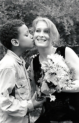 Boy giving his mother flowers UK 1990s