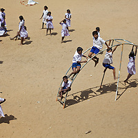 Students play in the grounds of the new Palchenai school. <br /> <br /> The UNICEF- built Palchenai school educates 581 pupils 1-12 Grade. The original Palchenai school building was badly damaged by the tsunami and eleven students lost their lives. UNICEF provided four semi-permanent teaching buildings during the transition period before the new school building was constructed. Work on this building began in 2006 but was halted later that year when a local escalation in the Sri Lankan conflict forced the entire community served by the school to relocate their homes. Most had returned back by early 2007 when the school again began teaching. The new school building constructed by UNICEF was opened in June 2008. UNICEF provides teacher training in Child Friendly Schooling.<br /> <br /> Photo: Tom Pietrasik<br /> Batticaloa District, Sri Lanka<br /> October 1st 2009