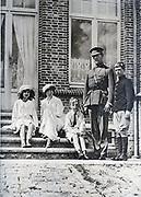 The Belgian Royal Family at their villa in devastated Flanders (King Albert in uniform)