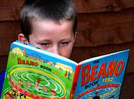 Young Boy Reading a Beano Annual - 2013