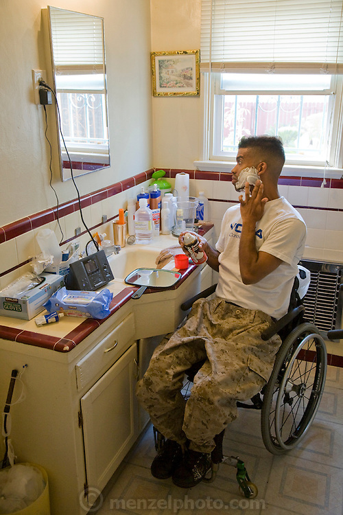 Felipe Adams, a 30-year-old Iraq war veteran who was paralyzed by a sniper's bullet in Baghdad, Iraq shaves at his home in Inglewood, California. (Felipe Adams is featured in the book What I Eat: Around the World in 80 Diets.) MODEL RELEASED.