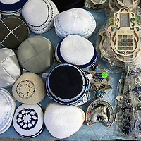 Amulets, souvenirs and Jewish accessories are being sold to the visitors at the little shop ouside the grave of Yonatan ben Uziel at Amukah in the Galilee in Israel.Over the centuries the tradition developed that those seeking for their soul-mates would be married within one year if they prayed at Rabbi Ben-Uziel's tomb.