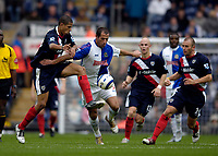 Photo: Jed Wee.<br />Blackburn Rovers v West Bromwich Albion. The Barclays Premiership. 01/10/2005.<br /><br />Blackburn hero Shefki Kuqi cuts a swath through the West Brom defence on a powerful run.