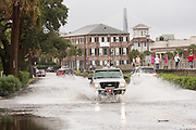 Cars plow through floodwater along the Battery in the historic district as Hurricane Joaquin brings heavy rain, flooding and strong winds as it passes offshore October 4, 2015 in Charleston, South Carolina.