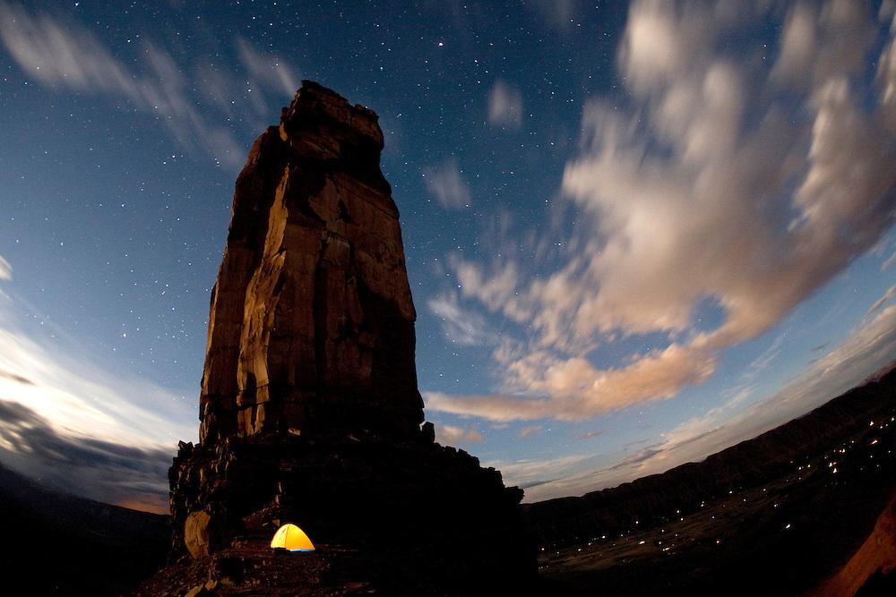 Night shot of tent taken while backpacking under Castleton Tower near Moab, UT. Castle Valley, UT.