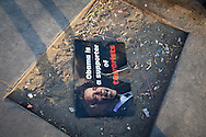 A disguarded poster on 6th of October bridge in Cairo, where violent clashes between Muslim Brotherhood, and anti-government groups broke out the previous night, leaving many dead.