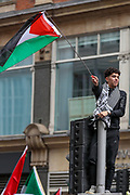 London, United Kingdom, May 15, 2021: A man waves a Palestinian flag as he stands on a traffic light during a pro-Palestinian rally outside the Israeli Embassy in central London on Saturday, May 15, 2021. This is the 3rd week of ongoing demonstrations across the United Kingdom with 25 demonstrations taking place across the country today. (Photo by Vudi Xhymshiti/VXP)