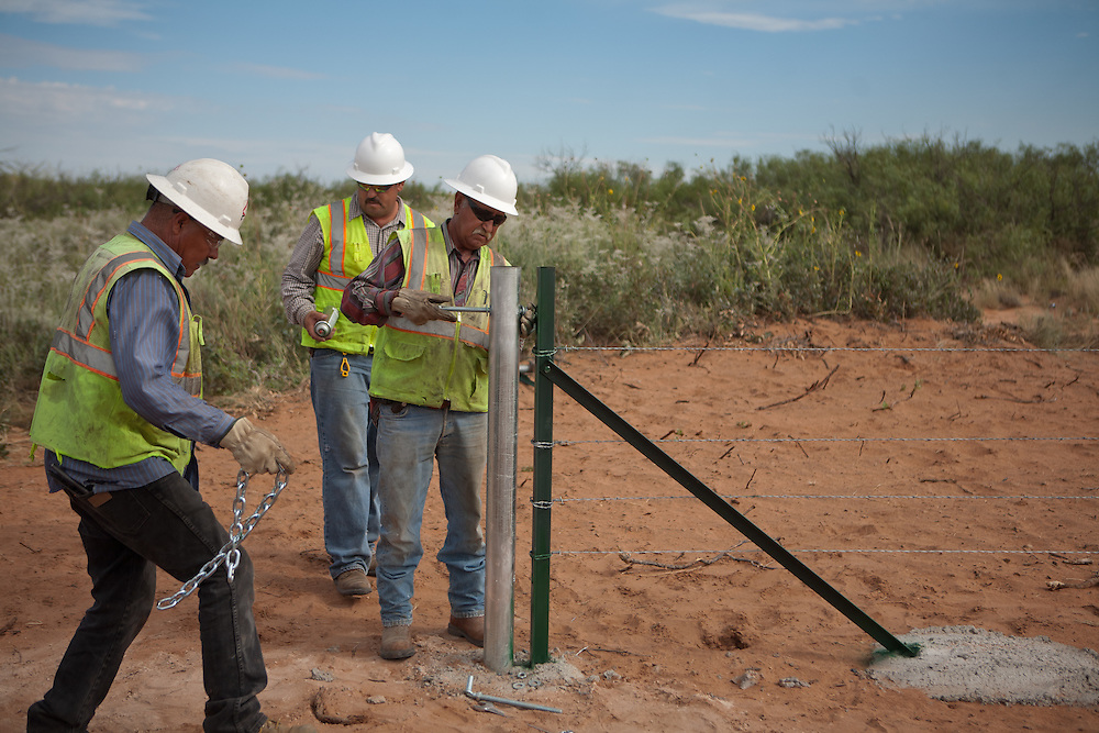 A construction crew works on a gate along the new highway under construction near The Waste Isolation Pilot Plant in Eddy County. WIPP received $172 million as part of the Recovery and Reinvestment Act. The highway will increase access for trucks carrying nuclear waste to the WIPP.