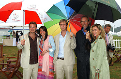 Left to right, , TOM RUTHERFORD, NAOMI FRANKS, HARRY RUTHERFORD and ANGIE & MIKE RUTHERFORD at the 2005 Cartier International Polo between England & Australia held at Guards Polo Club, Smith's Lawn, Windsor Great Park, Berkshire on 24th July 2005.<br /><br />NON EXCLUSIVE - WORLD RIGHTS
