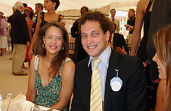 MISS ARABELLA MUSGRAVE and LORD FREDERICK WINDSOR at the 2004 Cartier International polo day at Guards Polo Club, Windsor Great Park, Berkshire on 25th July 2004.