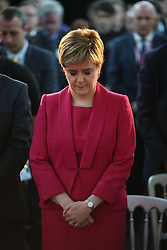 First Minister Nicola Sturgeon observes a minute's silence during a visit to the Advanced Forming Research Centre in Renfrew, Glasgow, in memory of those who died in the Grenfell Tower fire in west London last week.
