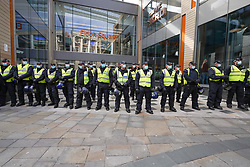© Licensed to London News Pictures. 25/09/2021. Newcastle, UK. Riot Police stand guard outside Eldon Square shopping centre in Newcastle as anti vaxxers take part in a demonstration against mandatory vaccination passports and the vaccination of teenagers.  Photo credit: Ioannis Alexopoulos/LNP