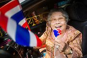 01 FEBRUARY 2014 - BANGKOK, THAILAND: An elderly anti-government protestor on Chareon Krung Road in the Chinatown section of Bangkok. The anti-government protest movement, led by the People's Democratic Reform Committee (PDRC) organized a march through the Chinatown district of Bangkok Saturday and disrupted the city's famous Chinese New Year festival. Some streets were blocked and protest leader Suthep Thaugsuban walked through the neighborhood collecting money. The march was in advance of massive protests the PDRC has promised for Sunday, Feb. 2 in an effort to block Thais from voting in the national election.     PHOTO BY JACK KURTZ