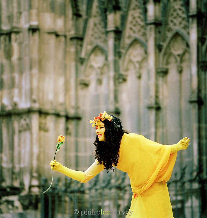 A street performer outside La Sagrada Familia, a large Roman Catholic church  and UNESCO World Heritage Site, Barcelona, Spain