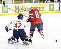 Ishockey <br /> Landskamp , <br /> Halden ishall , <br /> Norge - Frankrike , <br /> 03.04.08 , <br /> Eirik Skadsdammen , <br /> Fabrice Lhenry , <br /> Foto: Thomas Andersen / Digitalsport