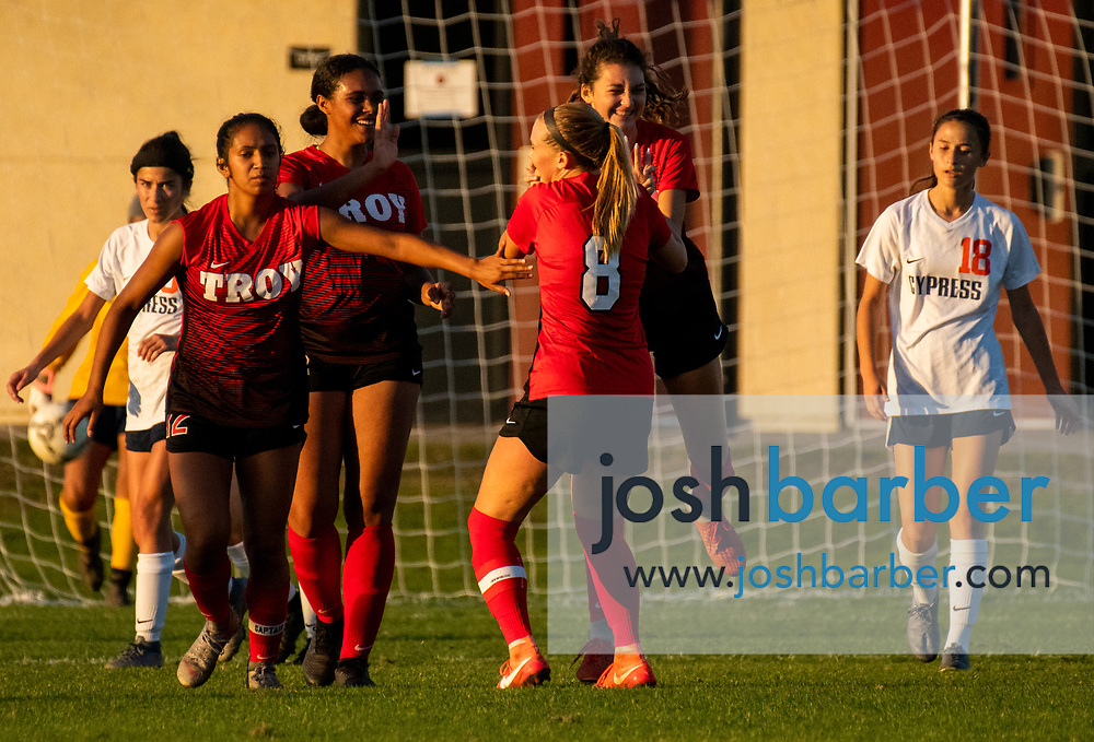 Troy's Isabella Ales (17), center-right, celebrates after scoring a second half goal against Cypress by giving teammate Kendall Carter (8), center-left, a jumping high-five during the nonleague game at Troy High School on Thursday, December 12, 2019 in Fullerton, Calif. (Photo by Josh Barber for The Orange County Register/SCNG)