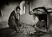 High Albania, the Accursed Mountains. Widow in Valbone home with the corn to last the coming winter.