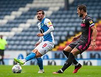 Blackburn Rovers' Joe Rothwell plays a pass under pressure from Leeds United's Liam Cooper<br /> <br /> Photographer Alex Dodd/CameraSport<br /> <br /> The EFL Sky Bet Championship - Blackburn Rovers v Leeds United - Saturday 4th July 2020 - Ewood Park - Blackburn<br /> <br /> World Copyright © 2020 CameraSport. All rights reserved. 43 Linden Ave. Countesthorpe. Leicester. England. LE8 5PG - Tel: +44 (0) 116 277 4147 - admin@camerasport.com - www.camerasport.com
