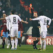 Referee's Tolga OZKALFA show the red card to Besiktas's Tomas SIVOK (L) during their Turkish Superleague Derby match Besiktas between Trabzonspor at the Inonu Stadium at Dolmabahce in Istanbul Turkey on Sunday, 06 March 2011. Photo by TURKPIX