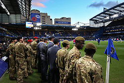 5 November 2017 - Premier League Football - Chelsea v Manchester United - Soldiers who are to take part in the Remembrance Day ceremony wait on the sidelines at Stamford Bridge as the players warm up - Photo: Charlotte Wilson / Offside
