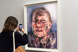 "© Licensed to London News Pictures. 11/04/2019. LONDON, UK. A visitor views ""Untitled"", 2019, by Jenny Saville, a new work, seen for the first time, created in response to Rembrandt's self-portrait, ""Self-Portrait with Two Circles"" which is the highlight of the exhibition.  Preview of ""Visions of the Self:  Rembrandt and Now"", an exhibition at Gagosian Grosvenor Hill, in partnership with English Heritage.  The show features self-portraits by Pablo Picasso, Frances Bacon, Lucian Freud and Jean-Michel Basquiat alongside contemporary artists including George Baselitz, and Damian Hirst.  Photo credit: Stephen Chung/LNP"