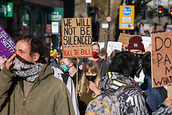 © Licensed to London News Pictures. 03/04/2021. Bristol, UK. Protesters march through the streets of Bristol during the 'Kill the Bill' demonstration. Crowds gathered to protest against the proposed Police, Crime, Sentencing and Courts Bill. Photo credit: Peter Manning/LNP