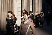 Scene as Chinese tourists walk around in the City of London in the afternoon winter light. Tourism from mainland China is now way easier for the tourist nowadays.