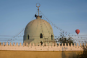 A hot air balloon and the roof of a local mosque in a West Bank village of the modern city of Luxor, Nile Valley, Egypt. Islam in Egypt is the dominant religion in a country with around 80 million Muslims, comprising 94.7% of the population, as of 2010. Almost the entirety of Egypt's Muslims are Sunnis, with a small minority of Shia and Ahmadi Muslims. The latter, however, are not recognised by Egypt.